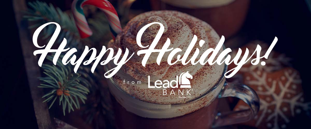 A cup of hot chocolate with the words Happy Holidays from Lead Bank overlayed