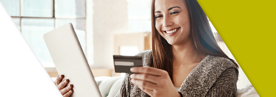 A woman using her Lead Bank debit card to make a purchase on an ipad